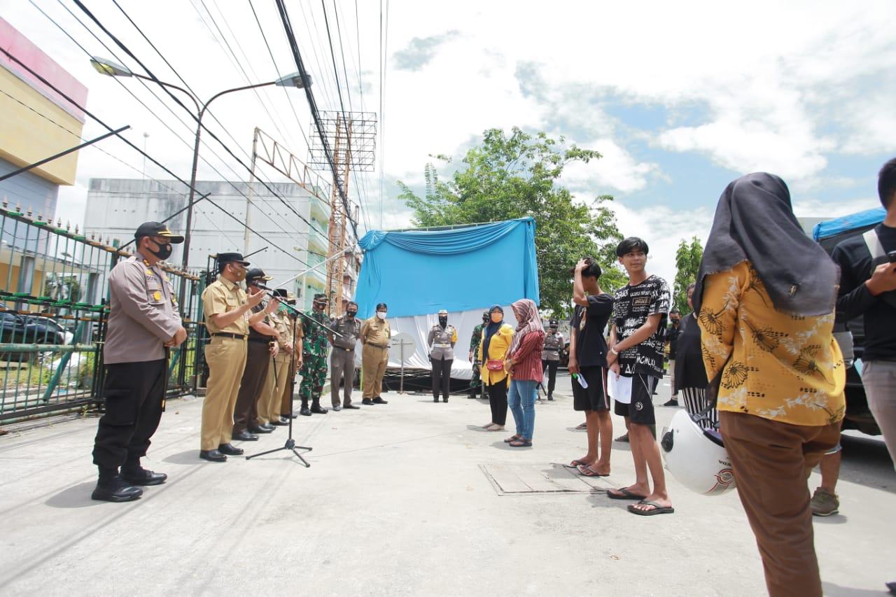 Pjs Bupati Siak Sosialisasikan Penindakan Disiplin Non Yustisi Protokol Kesehatan di Kec Tualang.